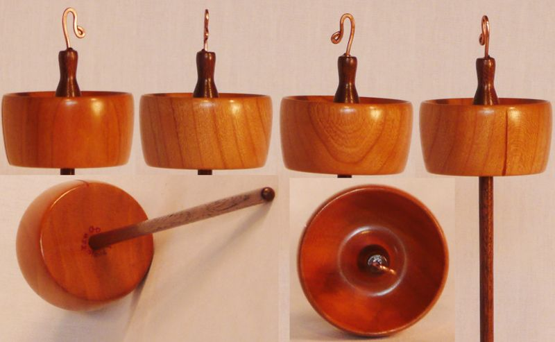 Hand turned top whorl drop spindle of Cherry on Walnut by Cynthia Haney