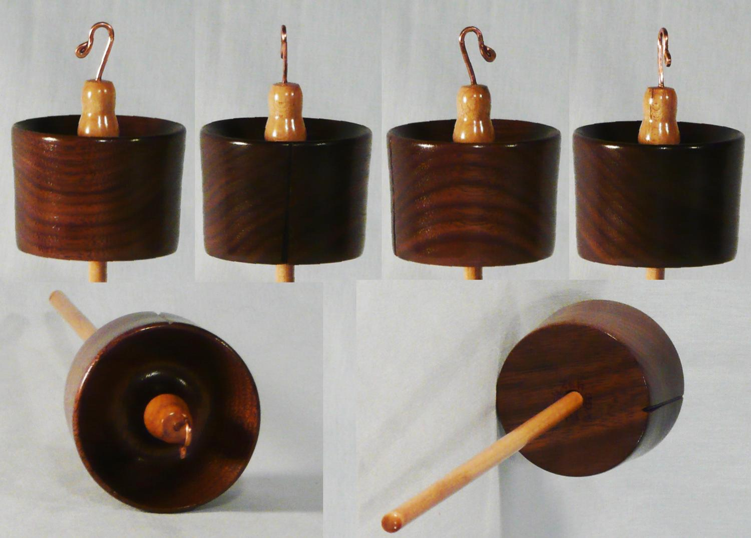 Hand turned high whorl drop spindle by Cynthia D. Haney of Walnut on Maple.