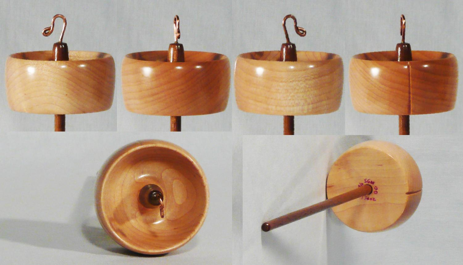 Hand turned high whorl drop spindle by Cynthia D. Haney of Quilted Maple on Walnut.