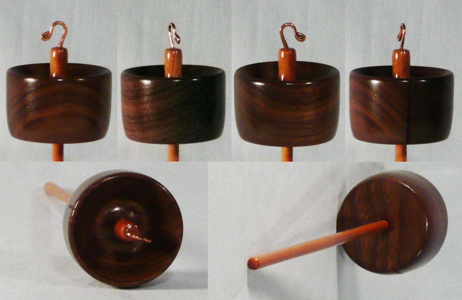 Hand turned high whorl drop spindle by Cynthia D. Haney of Walnut and Cherry woods.