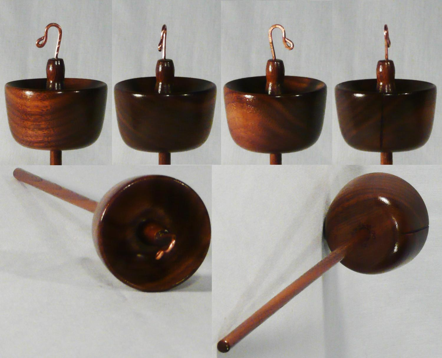 Hand turned high whorl drop spindle by Cynthia D. Haney of Walnut wood.